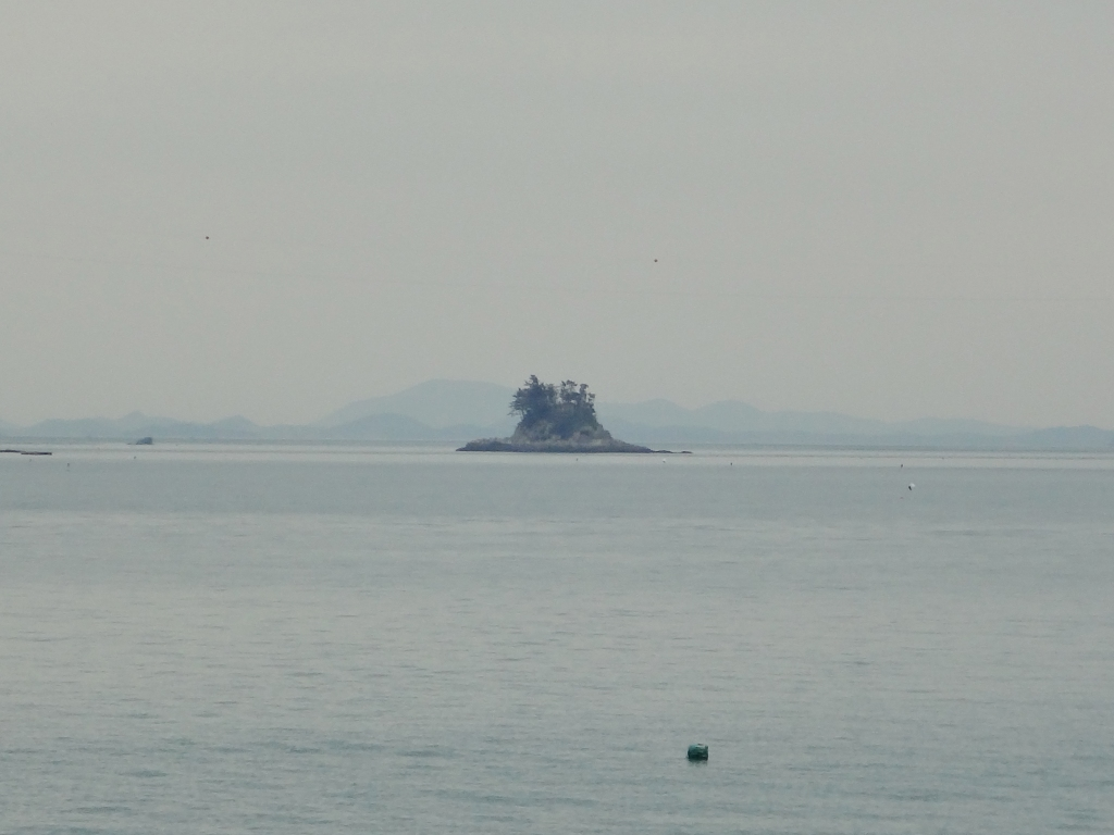 An island that looks like the hat from The Little Prince, visible from the Jindo coast