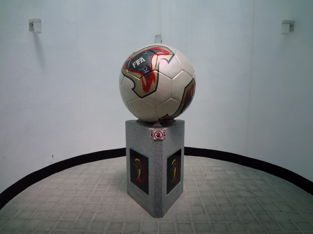 A FIFA cup is displayed near the bathrooms.