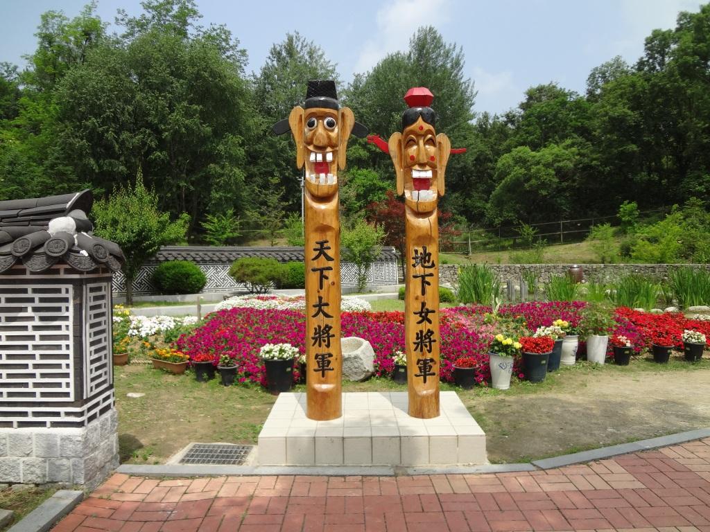 Korean totem poles (jangseung) greet visitors.